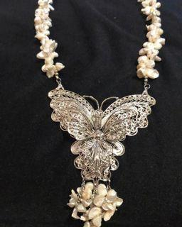 Fresh water pearl necklace with silver butterfly pendant