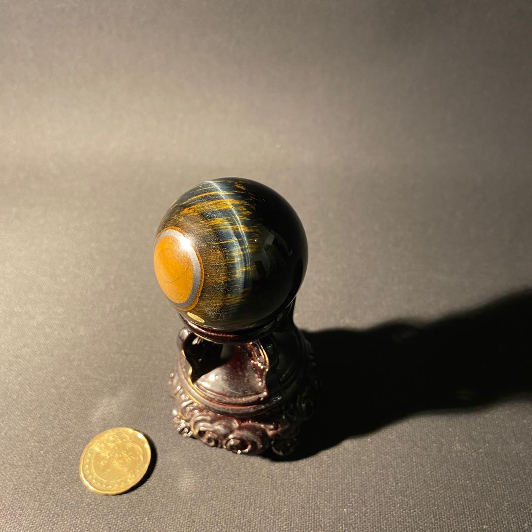 Golden blue tiger eye with an Eye Crystal sphere healing deco