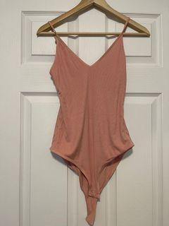 Aritzia peach body suit