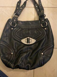 Black leather handbags used