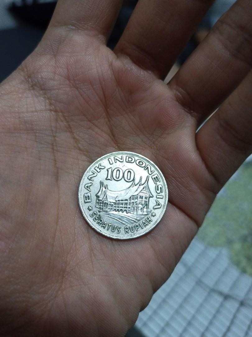 Uang kuno 100 perak tahun 1978 gambar wayang rumah gadang