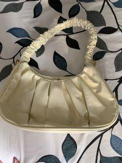 Bag yellow scrunchies