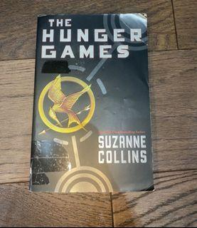 """""""Hunger games"""" by Suzanne Collins paperback novel"""