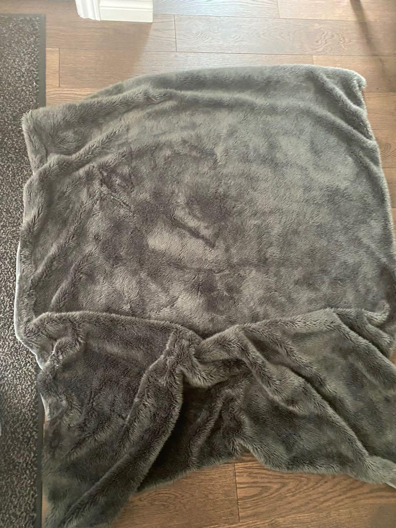 Grey furry throw blanket