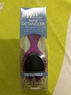 The wet brush mini sisir