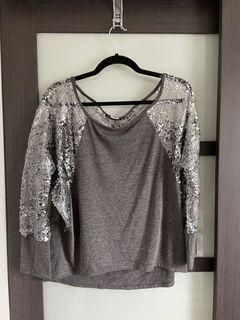 Sweater with sequin sleeves