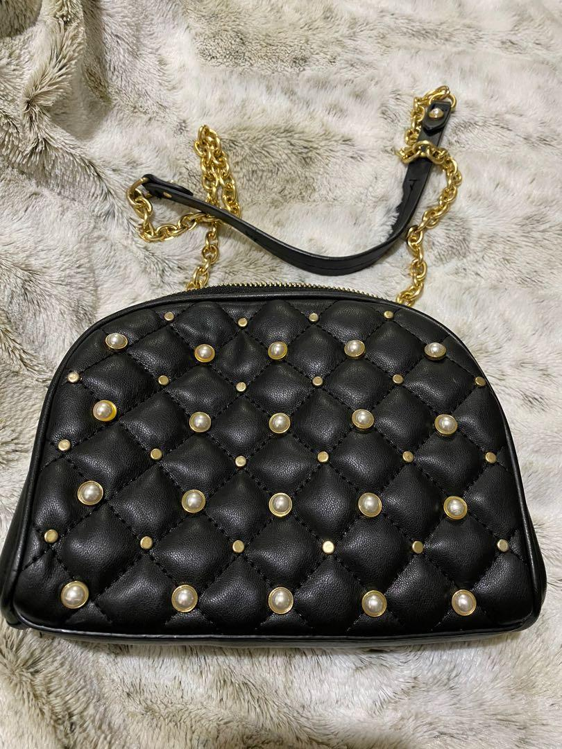 Zara chain on wallet bag