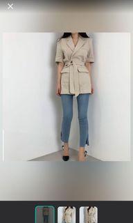 Belted beige outerwear