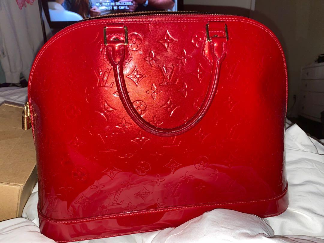 Selling this used once Authentic Louis Vuitton GM Alma Bag,