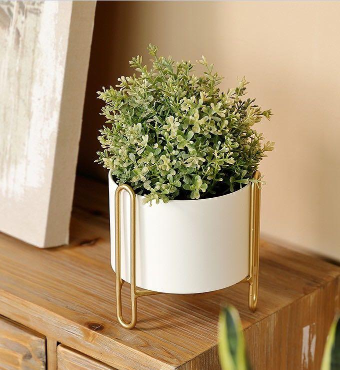 Mid century styled white pot in gold stand