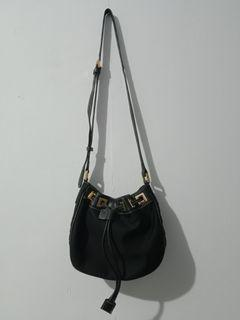 Mial purse black leather canvas pull string slingbag