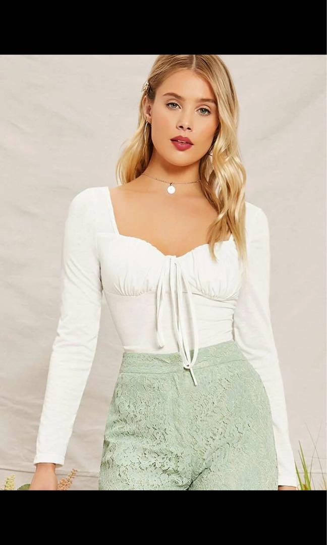 White long sleeve tie knit top