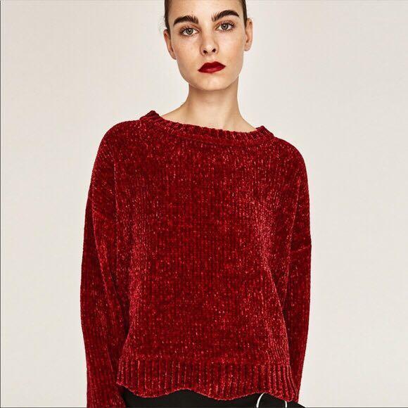Burgundy/red velvet knitted sweater.