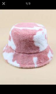 Fuzzy cow print bucket hat