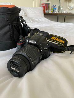 NIKON D5100 with lens and carrying case