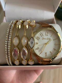 Gold watch and bracelets set