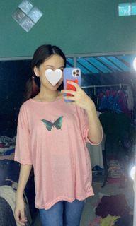 Kaos pink motif kupu-kupu