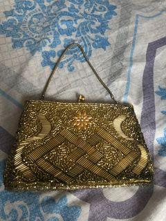Vintage clutch bag made of gold beads