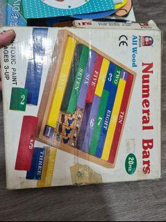 Bundle of wooden jigsaw block number block and pinart