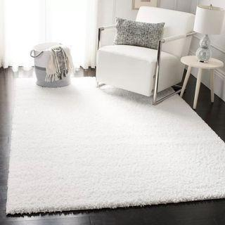 Large white rug (100% new, STILL ROLLED. Never opened.)