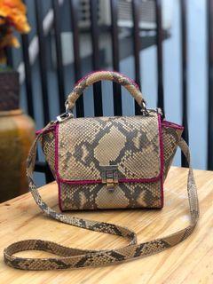 Tas kulit ular asli