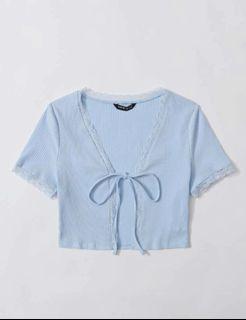 light blue knot front lace trim rip knit top