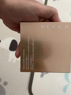 becca highlighter champagne pop