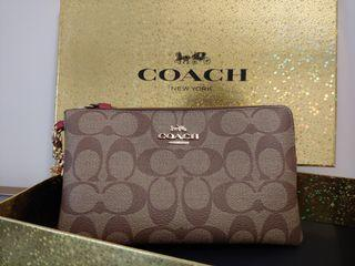 Coach Large Wristlet w/ box and charms