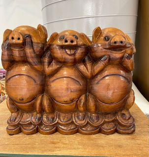 Solid wooden pig statue