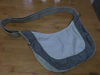 Hedgren light grey sling bag with adjustable straps 8x14x1.5inches