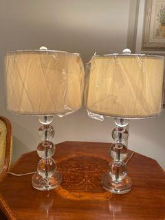 A set of 2 heavy glass ball lamps in new condition