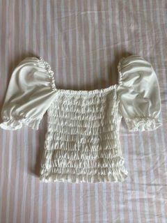 White smocked puffed top