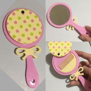 Kids pink and yellow hand mirror with small comb