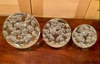 A Set of 3 heavy decorative glass balls with bubbles inside