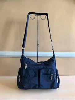 Pre-owned Baggalini Brand Sling or Body Bag from U.S     Dimension: - Height = 9 inch - Length = 10 inch * Nice in actual   Modes of Payment: BPI, LBC or Cebuana   Shipping: Your item/s will be shipped a day or next day after payment has been made.