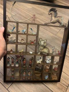 Miniature items wall display glass enclosed