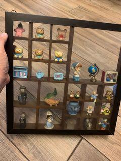 Miniature toys - glass wall display