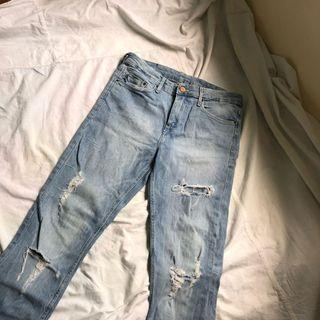 H&M mid-waist light washed ripped jeans